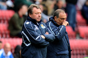West Ham United Manager Avram Grant (R) looks on during the Barclays Premier League match between Wigan Athletic and West Ham United at the DW Stadium on May 15, 2011 in Wigan, England.