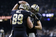 Josh Hill #89 of the New Orleans Saints celebrates after catching the ball for a touchdown with Drew Brees #9 during the first half of the NFC Wild Card playoff game against the Carolina Panthers at the Mercedes-Benz Superdome on January 7, 2018 in New Orleans, Louisiana.
