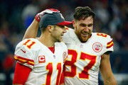 Travis Kelce #87 and quarterback Alex Smith #11 of the Kansas City Chiefs celebrate a fourth quarter touchdown by Spencer Ware (not pictured) during the AFC Wild Card Playoff game against the Houston Texans at NRG Stadium on January 9, 2016 in Houston, Texas.
