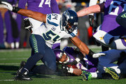 Adrian Peterson #28 of the Minnesota Vikings is tackled in the fourth quarter against the Seattle Seahawks during the NFC Wild Card Playoff game at TCFBank Stadium on January 10, 2016 in Minneapolis, Minnesota.