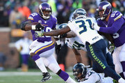 Kam Chancellor #31 of the Seattle Seahawks attempts to tackle Adrian Peterson #28 of the Minnesota Vikings in the first quarter during the NFC Wild Card Playoff game at TCFBank Stadium on January 10, 2016 in Minneapolis, Minnesota.
