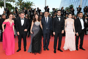 "(L-R) Actress Bennu Yildirimlar, actor Murat Cemcir, writer Ebru Ceylan, director Nuri Bilge Ceylan, actor Dogu Demirkol, actress Hazar Erguclu and actor Akin Aksu attend the screening of ""The Wild Pear Tree (Ahlat Agaci)"" during the 71st annual Cannes Film Festival at Palais des Festivals on May 18, 2018 in Cannes, France."