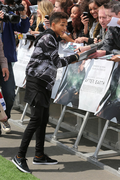 Jaden Smith signs autographs as he attends UEFA's Champions Festival which comes to London to coincide with Wembley hosting the Champions League final at Queen Elizabeth Olympic Park on May 25, 2013 in London, England.  Jaden Smith and Will Smith are in London ahead of the release of their film 'After Earth'.