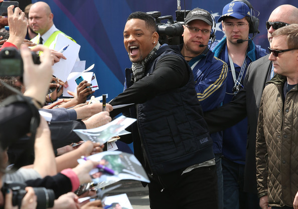 Will Smith signs autographs as he attends UEFA's Champions Festival which comes to London to coincide with Wembley hosting the Champions League final at Queen Elizabeth Olympic Park on May 25, 2013 in London, England.  Jaden Smith and Will Smith are in London ahead of the release of their film 'After Earth'.