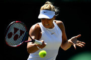 Sabine Lisicki of Germany plays a forehand against Anna Kalinskaya of Russia during Wimbledon Championships Qualifying - Day 2 at The Bank of England Sports Centre on June 26, 2018 in London, England.