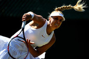 Sabine Lisicki of Germany serves against Anna Kalinskaya of Russia during Wimbledon Championships Qualifying - Day 2 at The Bank of England Sports Centre on June 26, 2018 in London, England.