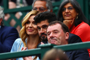Katherine Jenkins and her husband Andrew Levitas watch the action next to Philip Brook, chairman of the All England Lawn Tennis and Croquet Club during the Wimbledon No. 1 Court Celebration in support of the Wimbledon Foundation at All England Lawn Tennis and Croquet Club on May 19, 2019 in London, England.