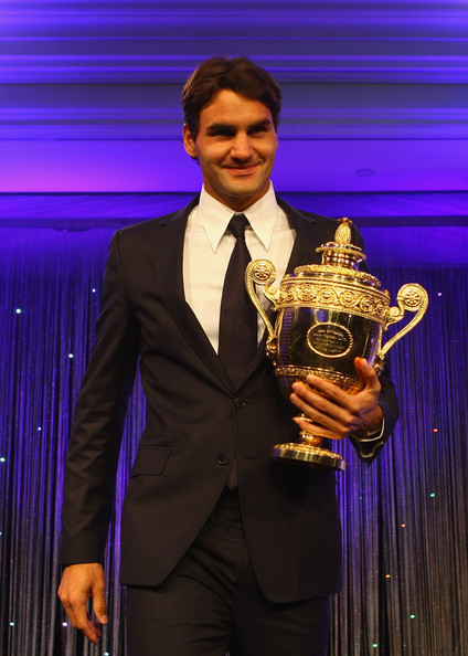 Roger Federer holds the Trophy at the Wimbeldon Winners Party at the Hotel Intercontinental on July 5, 2009 in London, England.