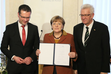 Winfried Kretschmann Merkel Receives Eugen Bolz Award For Her Refugees Policy