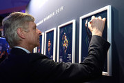Arsene Wenger winner of the Laureus Lifetime Achievement award signs the wall  during the 2019 Laureus World Sports Awards on February 18, 2019 in Monaco, Monaco.