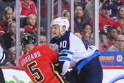 Joel Armia #40 of the Winnipeg Jets checks Mark Giordano #5 of the Calgary Flames  during an NHL game at Scotiabank Saddledome on January 20, 2018 in Calgary, Alberta, Canada.