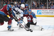 Goaltender Semyon Varlamov #1 of the Colorado Avalanche looks to make a save against Adam Lowry #17 of the Winnipeg Jets at the Pepsi Center on January 2, 2018 in Denver, Colorado.