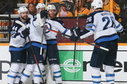 Josh Morrissey #44, Mark Scheifele #55,Kyle Connor #81, and Blake Wheeler #26 of the Winnipeg Jets celebrate a goal against the Nashville Predators during the second period of Game Five of the Western Conference Second Round during the 2018 NHL Stanley Cup Playoffs at Bridgestone Arena on May 5, 2018 in Nashville, Tennessee.