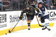 Luca Sbisa #47 of the Vegas Golden Knights is defended by Paul Stastny #25 of the Winnipeg Jets during the first period in Game Four of the Western Conference Finals during the 2018 NHL Stanley Cup Playoffs at T-Mobile Arena on May 18, 2018 in Las Vegas, Nevada.