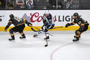 Paul Stastny #25 of the Winnipeg Jets is defended by James Neal #18 and Shea Theodore #27 of the Vegas Golden Knights during the first period in Game Four of the Western Conference Finals during the 2018 NHL Stanley Cup Playoffs at T-Mobile Arena on May 18, 2018 in Las Vegas, Nevada.