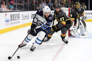 Paul Stastny #25 of the Winnipeg Jets is pursued by Shea Theodore #27 of the Vegas Golden Knights during the first period in Game Four of the Western Conference Finals during the 2018 NHL Stanley Cup Playoffs at T-Mobile Arena on May 18, 2018 in Las Vegas, Nevada.