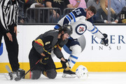 Colin Miller #6 of the Vegas Golden Knights and Paul Stastny #25 of the Winnipeg Jets get tangled up during the first period in Game Four of the Western Conference Finals during the 2018 NHL Stanley Cup Playoffs at T-Mobile Arena on May 18, 2018 in Las Vegas, Nevada.