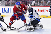 Brendan Gallagher #11 of the Montreal Canadiens tries to get a shot on goaltender Steve Mason #35 of the Winnipeg Jets during the NHL game at the Bell Centre on April 3, 2018 in Montreal, Quebec, Canada.  The Winnipeg Jets defeated the Montreal Canadiens 5-4 in overtime.
