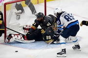 Mathieu Perreault #85 of the Winnipeg Jets misses a shot on goal as Pierre-Edouard Bellemare #41 falls on top of goalie Marc-Andre Fleury #29 of the Vegas Golden Knights during the second period in Game Three of the Western Conference Finals during the 2018 NHL Stanley Cup Playoffs at T-Mobile Arena on May 16, 2018 in Las Vegas, Nevada.
