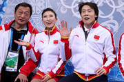 Qing Pang (C) and Jian Tong (R) of China wait for their score during the Figure Skating Pairs Free Skating during day five of the 2014 Sochi Olympics at Iceberg Skating Palace on February 12, 2014 in Sochi, Russia.
