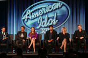 """(L-R) Ryan Seacrest, Keith Urban, Jennifer Lopez, Harry Connick, Jr., Trish Kinane and Per Blankens of the television show """"American Idol"""" speak during the FOX portion of the 2014 Television Critics Association Press Tour at the Langham Hotel on January 13, 2014 in Pasadena, California."""