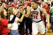 Tre'Von Willis #33 of the UNLV Rebels celebrates with fans after the Rebels defeated the  Wisconsin Badgers 68-65 at the Thomas & Mack Center November 20, 2010 in Las Vegas, Nevada.