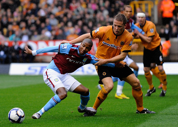 Christophe Berra Christophe Berra of Wolves battles with Ashley Young of Aston Villa during the Barclays Premier League match between Wolverhampton Wanderers and Aston Villa at Molineux on October 24, 2009 in Wolverhampton, England.