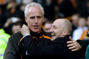 Wolves manager Mick McCarthy (L) and Blackpool manager Ian Holloway shake hands before kick off during the Barclays Premier League match between Wolverhampton Wanderers and Blackpool at Molineux on February 26, 2011 in Wolverhampton, England.