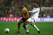 Ivan Cavaleiro of Wolverhampton Wanderers is challenged by Tom Huddlestone of Derby County during the Sky Bet Championship match between Wolverhampton Wanderers and Derby County at Molineux on April 11, 2018 in Wolverhampton, England.