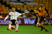 Scott Parker of Fulham battles for the ball with Danny Batth of Wolves during the FA Cup third round replay match between Wolverhampton Wanderers and Fulham at Molineux on January 13, 2015 in Wolverhampton, England.