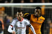 Scott Parker of Fulham battles for the ball with Rajiv Van La Parra of Wolves during the FA Cup third round replay match between Wolverhampton Wanderers and Fulham at Molineux on January 13, 2015 in Wolverhampton, England.
