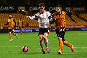 Matthew Doherty of Wolves and Scott Parker of Fulham battles for the ball during the FA Cup third round replay match between Wolverhampton Wanderers and Fulham at Molineux on January 13, 2015 in Wolverhampton, England.