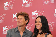 """Willem Dafoe and Giada Dafoe attend """"A Woman"""" photocall during the 67th Venice Film Festival at the Palazzo del Casino on September 4, 2010 in Venice, Italy."""
