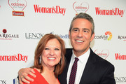 TV Personality Caroline Manzo and host Andy Cohen attend the Woman's Day Red Dress Awards on February 10, 2015 in New York City.