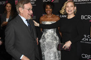 (L-R) Steven Spielberg, Gabrielle Union and Kate Hudson attend The Women's Cancer Research Fund's An Unforgettable Evening Benefit Gala at the Beverly Wilshire Four Seasons Hotel on February 28, 2019 in Beverly Hills, California.