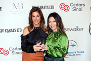 Cindy Crawford (L) and Elyse Walker attend the Women's Guild Cedars-Sinai annual luncheon at the Regent Beverly Wilshire Hotel on November 06, 2019 in Beverly Hills, California.