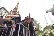 (L-R) Megan Rapinoe, Allie Long, Alex Morgan and Ashlyn Harris celebrate while riding on a float during The U.S. Women's National Soccer Team Victory Parade down the Canyon of Heroes on July 10, 2019 in New York City. The team defeated the Netherlands 2-0 Sunday in France to win the 2019 Women's World Cup.