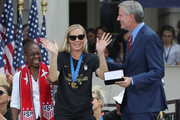 """Allie Long of the United States Women's National Soccer Team receives the key to the city from Chirlane McCray (l) and Mayor Bill de Blasio (r) during a ceremony at City Hall on July 10, 2019 in New York City. The honor followed a ticker tape parade up lower Manhattan's """"Canyon of Heroes"""" to celebrate their gold medal victory in the 2019 Women's World Cup in France."""