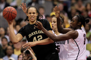 (L-R) Brittney Griner #42 of the Baylor Bears is pressured by Caroline Doty #5 and Tina Charles #31 of the Connecticut Huskies in the second half during the Women's Final Four Semifinals at the Alamodome on April 4, 2010 in San Antonio, Texas. Connecticut defeated Baylor 70-50.