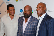 (L-R) Former professional basketball player Reggie Theus, Los Angeles Clippers Assistant Coach Mike Woodson and former professional basketball player Byron Scott arrive at the Coach Woodson Las Vegas Invitational red carpet and pairings gala at 1 OAK Nightclub at The Mirage Hotel & Casino on July 8, 2017 in Las Vegas, Nevada.