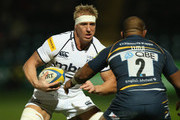 Andy Powell of Sale takes on Aleki Lutui during the Aviva Premiership match between Worcester Warriors and Sale Sharks at Sixways Stadium on October 26, 2012 in Worcester, England.