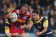 Jamie Roberts of Harlequins is tackled during the Aviva Premiership match between Worcester Warriors and Harlequins at Sixways Stadium on April 28, 2018 in Worcester, England.