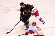 Morgan Rielly #44 of Team North America battles for the puck with Andrei Markov #79 of Team Russia in the third period during the World Cup of Hockey at the Air Canada Center on September 19, 2016 in Toronto, Canada. Team Russia won the game 4-3.