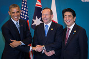 (L-R) U.S. President Barack Obama, Australian Prime Minister Tony Abbott, and Japan's Prime Minister Shinzo Abe shake hands during a trilateral meeting at the G20 Summit on November 16, 2014 in Brisbane, Australia. World leaders have gathered in Brisbane for the annual G20 Summit and are expected to discuss economic growth, free trade and climate change as well as pressing issues including the situation in Ukraine and the Ebola crisis.