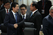Japanese Prime Minister Shinzo Abe (L) greets Prime Minister of Thailand Prayut Chan-o-cha (R) during a plenary session of the 2016 Nuclear Security Summit April 1, 2016 in Washington, DC. U.S. President Barack Obama is hosting the fourth and final in a series of summits to highlight accomplishments and make new commitments towards reducing the threat of nuclear terrorism.