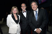 """(L-R) Actress Martha Plimpton, Director Chris Buck, and Producer Peter Del Vecho attend the world premiere of Disney's """"Frozen 2"""" at Hollywood's Dolby Theatre on Thursday, November 7, 2019 in Hollywood, California."""