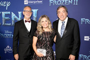"""(L-R) Director Chris Buck,  Director/writer/Walt Disney Animation Studios CCO Jennifer Lee, and Producer Peter Del Vecho attend the world premiere of Disney's """"Frozen 2"""" at Hollywood's Dolby Theatre on Thursday, November 7, 2019 in Hollywood, California."""