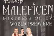 """(L-R) Actors Michelle Pfeiffer, Angelina Jolie, and Elle Fanning attend the World Premiere of Disney's """"Maleficent: Mistress of Evil"""" at the El Capitan Theatre on September 30, 2019 in Hollywood, California."""
