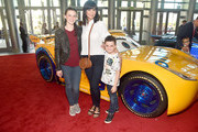 """(L-R) Gemma Beason, actor Catherine Bell, and Ronan Beason pose at the World Premiere of Disney/Pixar's """"Cars 3"""" at the Anaheim Convention Center on June 10, 2017 in Anaheim, California."""