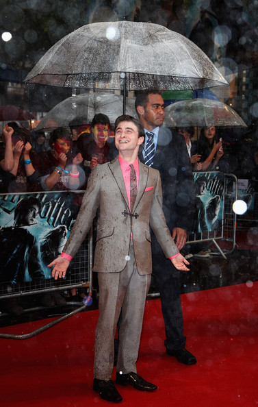 Daniel Radcliffe arrives as the rain pours down at the World Premiere of Harry Potter And The Half Blood Prince at Empire Leicester Square on July 7, 2009 in London, England.